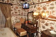 Centauera Hotel Alanya This traditional stone house in Tophane's historic district offers luxurious rooms with 24-hour room service. There is a spacious garden terrace with cushioned lounge sofas and wooden tables.