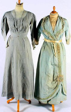 Left: a  day dress of gray cotton, with pin-tucked detail and buttons applied to the bodice, with whitework and lace inserts at the neck and cuffs. Right: a day dress of ice blue silk, with an embroidered net insert at the neckline and at the 3/4-length sleeves, edged with applied embroidered net and lace. Bonham's