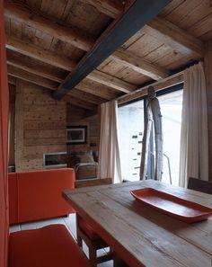 Attic in Cortina d'Ampezzo by Mario Mazzer Architects