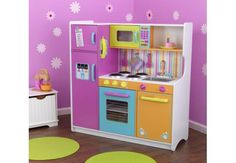 This play kitchen's detailed design and bright colors are sure to delight any small chef. The imaginary feasts from such a darling playroom addition are sure to be fantastic. Play Kitchens, Bright Kitchens, Kitchen Furniture, Kids Furniture, Kitchen Interior, Play Kitchen Sets, Cute Kitchen, Emma's Kitchen, Toddler Kitchen