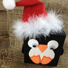 A cute penguin dressed for the holiday! Cute project for the kids to make over winter break. #beverlys #woodcraft