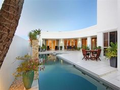 Landscaped pool design using tiles with outdoor dining & outdoor furniture setting - Pool photo 282876