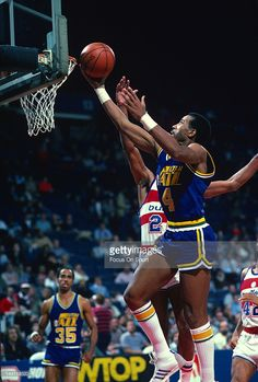 Adrian Dantley #4 of the Utah Jazz goes in to lay the ball up against the Washington Bullets during an NBA basketball game circa 1984 at the Capital Centre in Landover, Maryland. Dantley played for the Jazz from 1979-86.