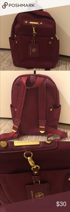 Adrienne Vittadini Backpack Adrienne Vittadini Backpack. Pristine condition, worn only a few times. Nice burgundy color with golden decor. Size: 15x10x6 Adrienne Vittadini Bags Backpacks