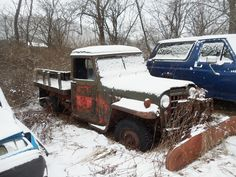 Willys Stake bed pickup in snow