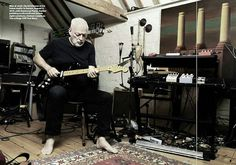 David Gilmour playing his guitar on farmhouse