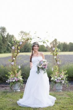 Graceful Floral Ceremony Arch | Ashley Cook Photography | Vintage Lace, Sunshine, and Lavender Fields Wedding Styled Shoot