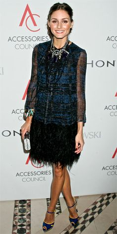 Palermo arrived at the ACE Awards in a graphic teal and black Giambattista Valli dress with bold accessories including a draped beaded necklace and cobalt heels with yellow accents.