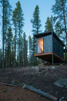 Located on a steep hillside in a lodgepole pine forest, these cabins were designed as micro dormitories for a community of outdoor educators. The cabins sit ...
