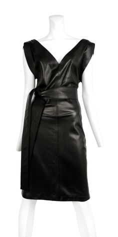 www.resurrectionvintage.com Versace LEATHER DRESS WITH DEEP NECKLINE Leather dress with deep v-neckline, zip back closure and wide leather sash belt.