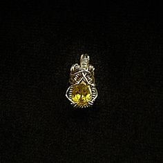 Hey, I found this really awesome Etsy listing at https://www.etsy.com/listing/11436919/yellow-sphene-wrapped-pendant