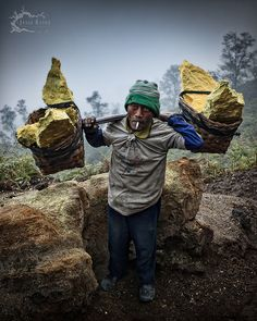 Ijen Miner - East Java, Indonesia is walking down and will get paid by the weight of what he is carrying.