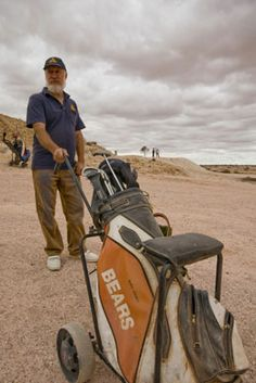 Golf in the desert While you're in town, grab a set of golf clubs and try your hand at a round on the Coober Pedy Opal Fields golf course.