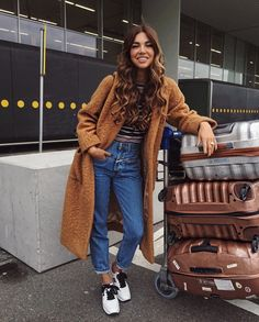 Casual jean and sneakers outfit paired with this orange beige long coat.#travel outfit