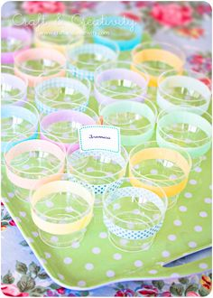 Decorate plastic cups. Save yourself a fortune & buy plain plastic cups & decorate them with patterned tape, dots or glue some ribbon.