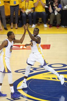 Kevin Durant and Draymond Green of the Golden State Warriors high five against the Cleveland Cavaliers in Game Five of the 2017 NBA Finals on June 12...