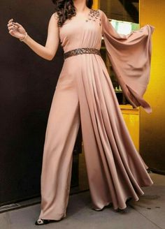 Jumpsuits For Women Are Back! is part of Dresses - Show you how to combine them and which colors are the most popular these days So, if you ready let's have a look at these stylish jumpsuits for women Indian Fashion Dresses, Indian Gowns Dresses, Dress Indian Style, Indian Designer Outfits, Indian Outfits, Designer Dresses, Indian Blouse, Designer Clothing, Hijab Fashion