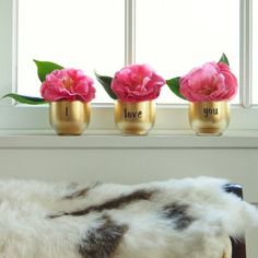 Turn thrifted glasses into gorgeous golden vases in 5 easy steps. This quick DIY project is sure to bring glitz to your Valentine's decor.