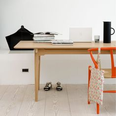 Hans Wegner Wishbone Chair in Orange.
