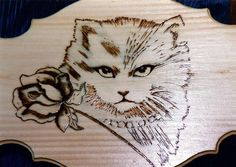 Woodburning Cat and Rose