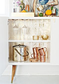 We're in love with Brittany Make's beautiful bar cabinet, which uses brass knobs and faux bois gold foil wrapping paper to create a high-style (and easy to make!) addition to any living room.