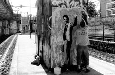 Street art : Poster entitled 'Pasolini' with the artist Zilda in action in Rome, Italy.