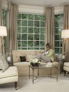 The other side of our master bedroom. It's a great little corner to sit and read, to relax and enjoy the view, or spend some quality time with our Maltese - Dudley. Neutral colors, simple window treatments, and symmetry keep the serene feel of the room.  Photo (C) Nancy E. Hill