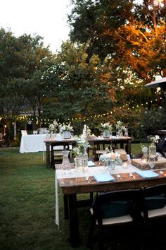 Garden string lights and farm house tables! Is there any other way to do a wedding? #cedarwoodweddings #nashvilleweddings #outdoorweddings
