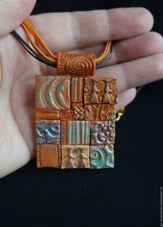 Embossed tiled pendant by Martina of Clay Carousel