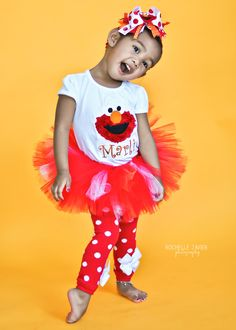 Elmo shirt for little girls -- fuzzy Elmo shirt -- perfect for Elmo birthday parties and shows. $28.00, via Etsy.