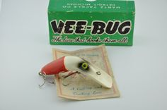 Vee Bug Antique Fishing Lure The Vee Bug Antique Fishing Lure is a neat fishing lure. The lure had two distinct body evolution, the first of which was wood having 4 hooks set up very similar to the flat fish, than then moving to a plastic based body with only 2T. This curved body antique lure...