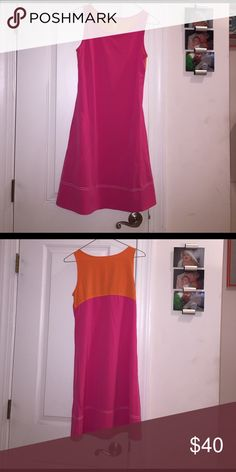 Title nine dress Adorable title nine pullover dress. Side pockets.  Solid hot pink front with a bold orange contrast on the upper back. Very loose fitting size small. title nine Dresses Midi