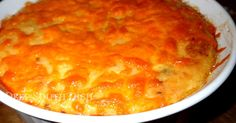 A souffle'd casserole of baked grits with cheese and sausage.