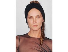 A fishtail braid turns '80s when secured under a black, turban-like headband on Erin Wasson.