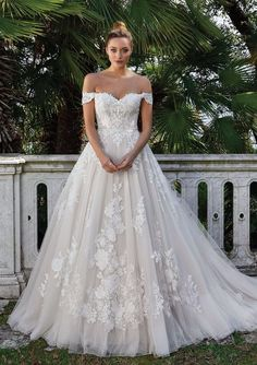 Feel like a princess in this Venice lace ball gown. With Point D'esprit tulle and off the shoulder detail. You will be remembered when you walk down the aisle.