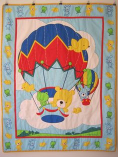 Another beautiful baby quilt with animals in a hot air balloon.