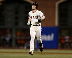 San Francisco Giants' Buster Posey (28) heads back to the dugout after grounding out in the ninth inning of Game 3 of baseball's World Series against the Kansas City Royals at AT&T Park in San Francisco, Calif., on Friday, Oct. 24, 2014.  (Nhat V. Meyer/Bay Area News Group)
