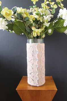 Buttoned hand knit vase cover. Manos del Uruguay Fino yarn in Rosewater.