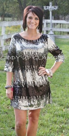Sparkle In Your Eye Black and Silver Sequin Dress  $39.95  http://www.giddyupglamouronline.com/catalog.php?item=6415
