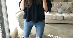 Ripped Levi's with booties and a black top. | fall fashion | fall style | winter style | winter fashion | how to style ripped jeans | ripped jean fashion tips | casual style for moms | motherhood in style || Katie Did What