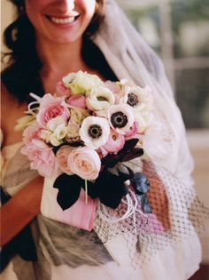 This lush bouquet bursts with anemones, begonias, ranunculus, protea and garden roses.