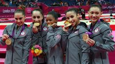 Team USA climb to top step of the podium after winning the women's artistic gymnastics. The team consisted of McKayla Maroney, Jordyn Wieber, Gabrielle Douglas, Alexandra Raisman and Kyla Ross. Russia won the silver and Romania the bronze. Defending champions China were fourth. - London 2012 Olympics