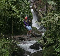 Zip line above a waterfall canyon ADR Adventure Park 10 in 1 in Manuel Antonio, Costa Rica  www.amigosdelrio.net