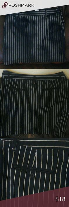 Tommy H striped black n white skirt Worn few times. In excellent condition. Zip closure on side as in pictures. Very fashionable. Size 10 ,material is stretchy . Look classy while feeling comfortable. Use very casual or dress it up with a jacket . You just cannot go wrong with this particular piece. Everyone needs a cute black striped skirt . Show off legs or wear with cute leggings. Dress up in heels or down in black slippers . Its a win win . I hate to part with this but I cant fit in it…