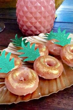 If you love donuts, you are going to love these pineapple-inspired ones. They are so easy to create. Just add some awesome pineapple leaf toppers and you are good to go! See more party ideas and share yours at CatchMyParty.com Luau Party Supplies, Luau Theme Party, Hawaiian Luau Party, Moana Birthday Party, Luau Birthday, Birthday Parties, Summer Birthday, Birthday Ideas, Pink Flamingo Party