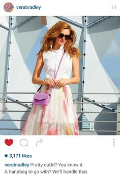 Love her outfit, love her purse, love her hair!