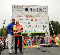 PAWS Chicago Founder, Paula Fasseas, with event emcee, CBS' Derrick Young - Photography by Jonny Blackstone