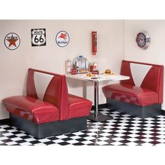 The black and white pattern of the floor is repetitive and contrasts well with the red booths in this diner.