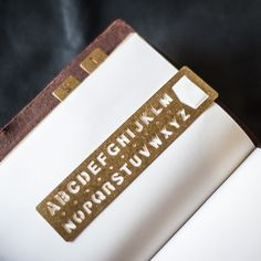 Brass Template Bookmark - Alphabet by Midori from Bookbinders Online