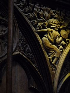 The wooden choir stalls in Winchester Cathedral, Hampshire, England which date to the 14th century are carved with elaborate patterns of foliage, flowers, animals, people and strange beasts. For example, the Green Man as seen here.